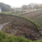 Curved bench and dry stone wall