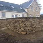 Round corner on the dry stone wall with turf top