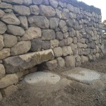 Dry stone wall with lintel to carry wall over a drain