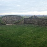 Circular dry stone bench and turf top