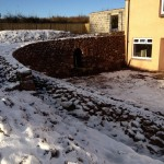 Dry stone retaining wall and terraces