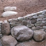 Dry stone wall and boulder steps