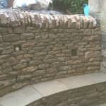 Dry stone retaining wall in a garden