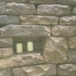 Dry stone retaining wall and candles
