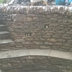Dry stone retaining wall and bench.