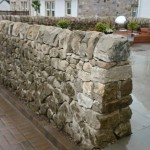 Cope stones on a dry stone wall