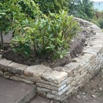 Curved dry stone retaining wall