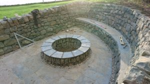 Dry stone seat and firepit
