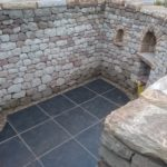 Dry stone seating space and pizza oven