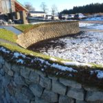 Curved turf topped dry stone wall