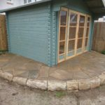 stone base for shed with crazy paving