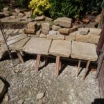 Putting together the large stones for the bench