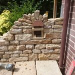 Dry stone recess under construction