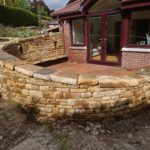 Dry stone bench and paving