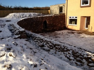 Red sandstone and whinstone retaining wall