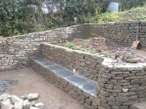Dry stone retaining wall and bench