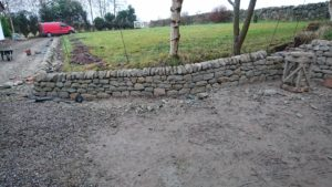 Low dry stone retaining wall