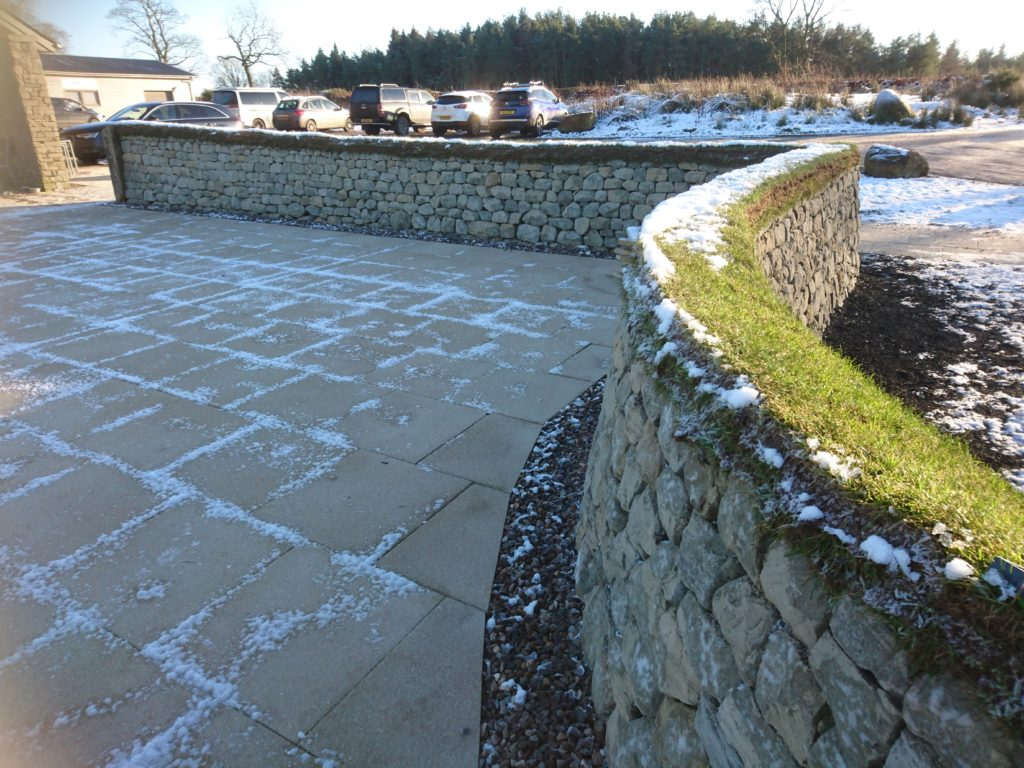 Dry stone wall and paving