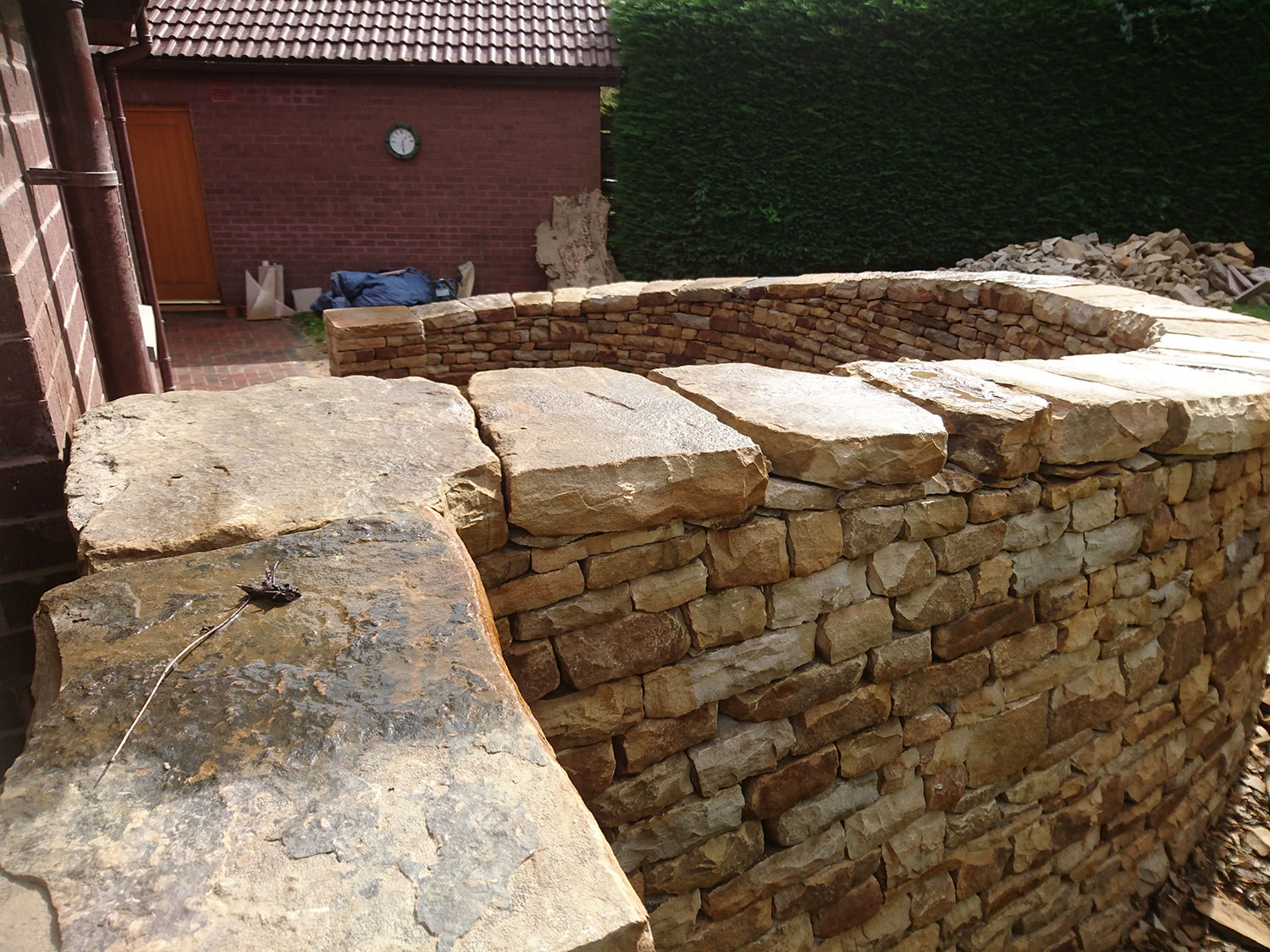 Dry stone bench and paving with large cap stone