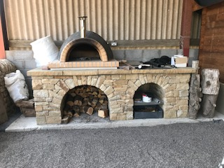 Dry stone pizza base with two arches