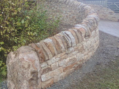 Curved drystone Entrance wall