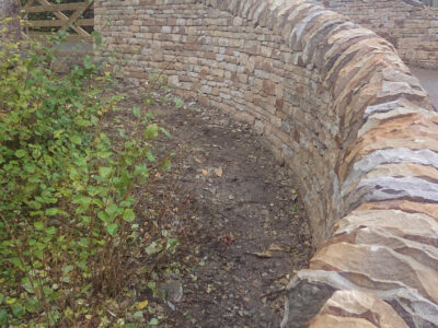 Curved drystone wall