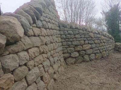 Dry stone retaining wall